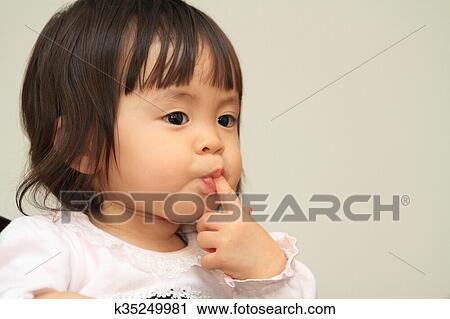 Japanese baby girl drinking water Stock Image