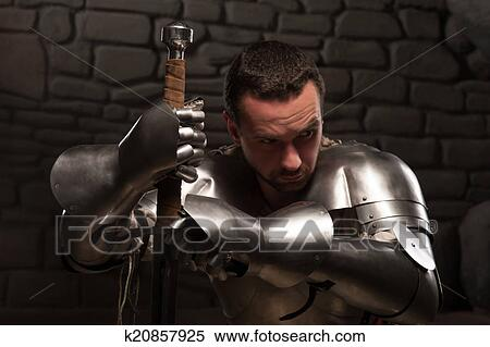 Medieval Knight Kneeling With Sword Stock Photography K20857925 Fotosearch