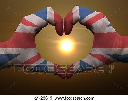 Gesture Made By United Kingdom Flag Colored Hands Showing Symbol Of Heart And Love During Sunrise