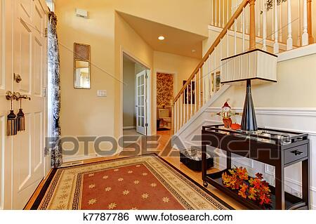 stock images of hallway and entrance with white staircase and warm