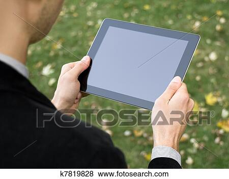 Businessman Holding A Tablet Pc Stock Photo