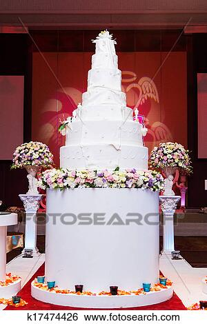 Stock images of a multi level white wedding cake on a silver base a multi level white wedding cake on a silver base and pink flowers on top mightylinksfo