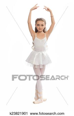 e658e7654717 Beautiful teen girl in white clothes ballet pose with long hair isolated on  white background