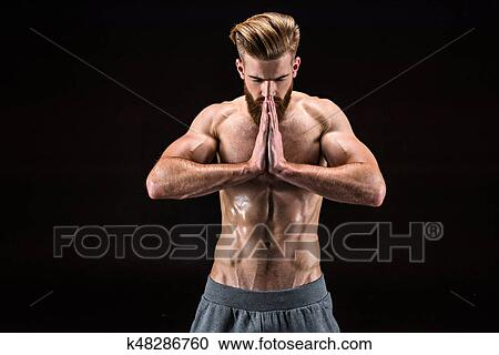 man in yoga pose with namaste gesture in relaxation yoga