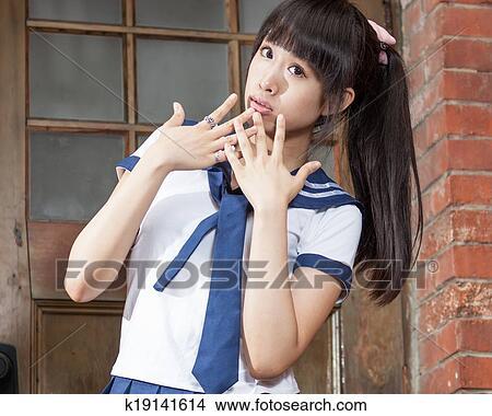 Chinese Schoolgirl In Front Of Red Brick School Building