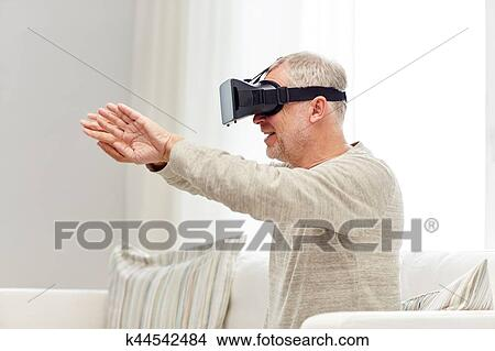 09bbeaf2ab3 Stock Photo - old man in virtual reality headset or 3d glasses. Fotosearch  - Search