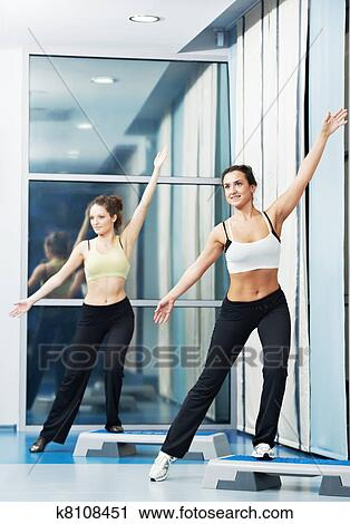 stock photography of women at aerobics exercise with fitness step