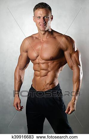 designer fashion 408ca 85700 Strong athletic man fitness model showing six pack abs Stock Image