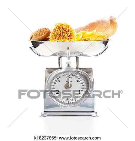 stock image of vegetables and fruits on a weighing scale k18237855