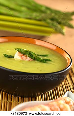Stock Photo of Cream of green asparagus with shrimp k8180973 ... 2052f528aad6