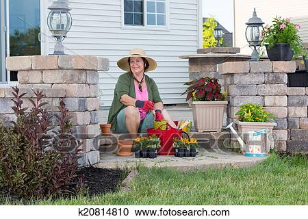 Stock Photography   Happy Grandma Planting In Her Garden. Fotosearch    Search Stock Photos,