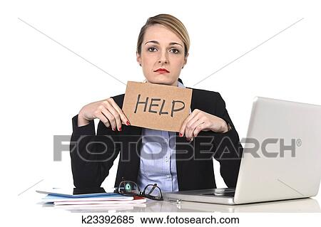 Young Stressed Businesswoman Holding Help Sign Overworked At Office Computer Stock Photography