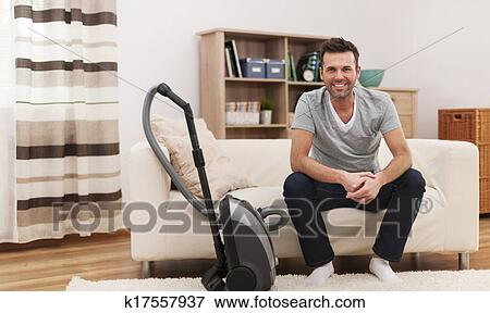 Picture Of Portrait Of Smiling Man With Vacuum Cleaner In Living