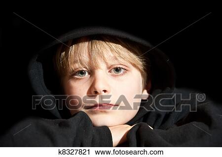 9f7f3cd4c7d Stock Photography - Portrait of young boy aged nine years old in black  hoodie. Fotosearch