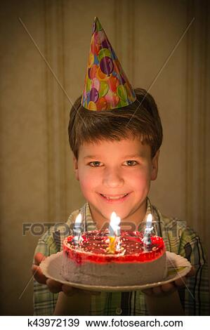 Stock Photograph Of Smiling Boy Holding Birthday Cake In Hands