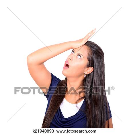 stock photo of portrait of young woman slapping hand on head