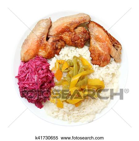 Fried chicken wings, boiled rice, pepper, beet on a white plate isolated on  white background with clipping path Stock Photography