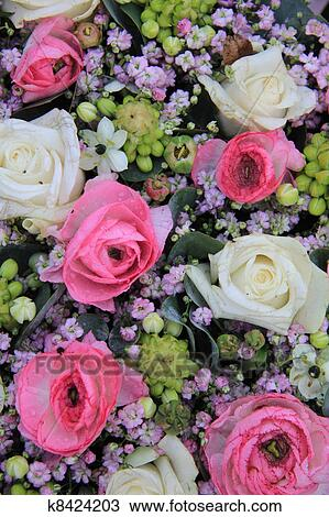 Stock photo of white pink and purple flower arrangement k8424203 floral arrangement with roses in white and pink mightylinksfo