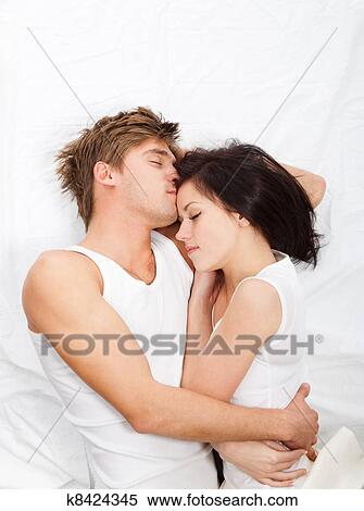 Stock Image Of Young Lovely Couple Lying In A Bed K60 Search Best Lovely Couple Com