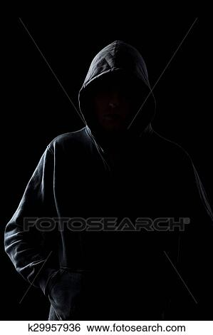 Stock Image - Faceless guy in hoodie in the darkness. Fotosearch - Search  Stock Photography 1af6cea8e
