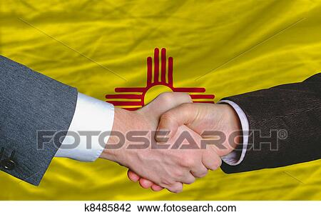 Stock Photo Of Two Businessmen Shaking Hands After Good Business