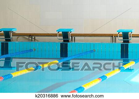 Starting blocks and lanes in a swimming pool Stock ...
