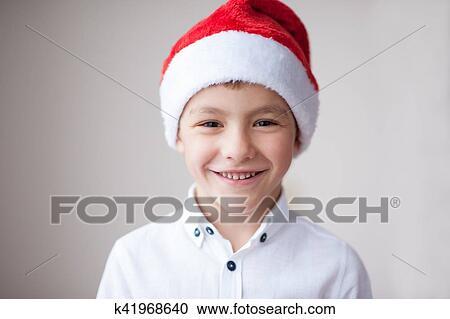 669b1afbb Hermoso, sonriente, niño, en, santa sombrero Colección de imágen ...