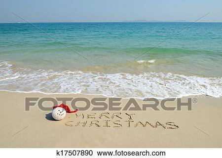 merry christmas written on tropical beach white sand with xmas snowman - Merry Christmas Beach Images
