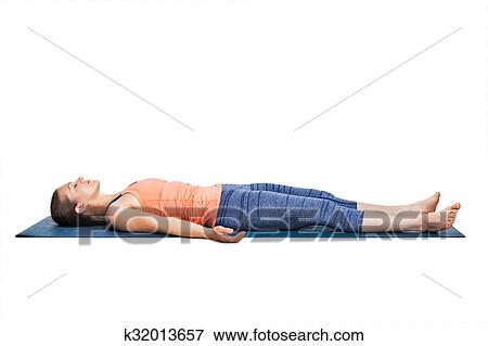 sporty woman relaxes in yoga asana savasana stock photo