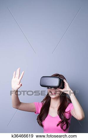 a0d2b437071f Smile happy woman getting experience using VR-headset glasses of virtual  reality at home much gesticulating hands