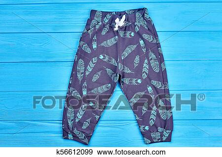 95faa627c48bd Stock photograph of kids feather print autumn pants jpg 450x319 Clipart  pocket leggings