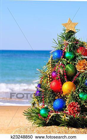 Christmas Beach.Christmas Tree On The Sand On The Beach Stock Image