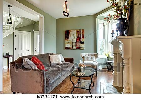Elegante, grün, wohnzimmer, mit, braunes sofa, und, holz, floor ...