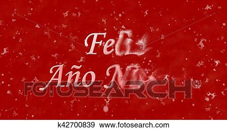 happy new year text in spanish feliz ano nuevo turns to dust from right on red background