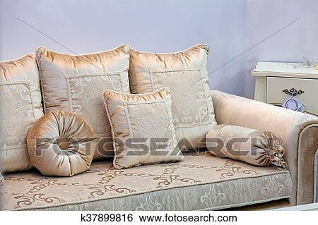 Gold Sofa With Pillows Stock Photograph