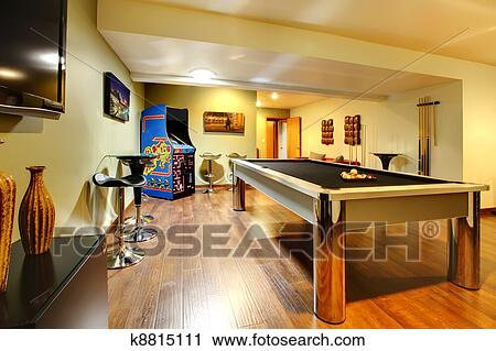 Basement Room Without Windows With Pool Table, TV, Games.
