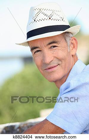 ebb0787b922bac Stock Photo of Older man in a straw panama hat k8824404 - Search ...