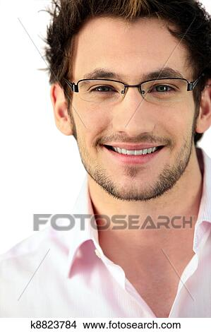 f4bd140b5ec Young man wearing glasses Picture