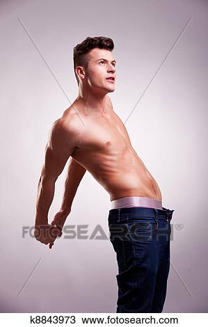 Stock Photo Of Muscular Man With No Shirt Stretching K8843973
