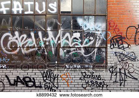 Graffiti Grunge Covered Brick Wall Background Texture Stock Image