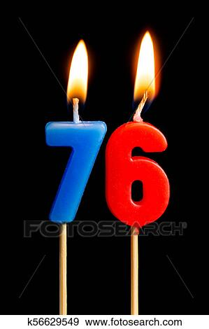 Burning Candles In The Form Of 76 Seventy Six Numbers Dates For Cake Isolated On Black