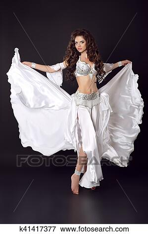 931c4160da312 Beautiful Arabian bellydancer sexy woman in bellydance colorful costume  isolated on black background. Sensual arabic girl belly dancer dancing.