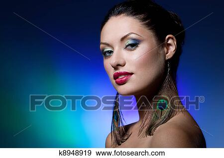 0f3bf51b78bc7 Young brunette with creative makeup Stock Photo | k8948919 | Fotosearch