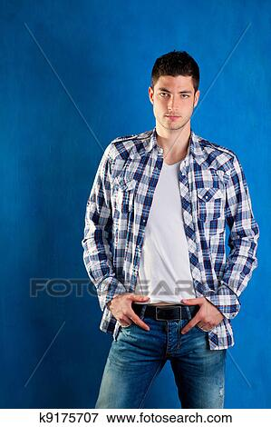 e176c9500f6 Handsome young man with plaid shirt denim jeans in blue Stock Photo ...