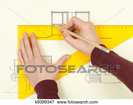 picture of woman s hand drawing architectural sketch of house
