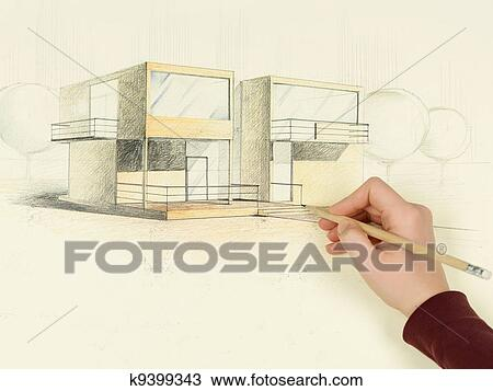 stock photo of woman s hand drawing architectural sketch of house