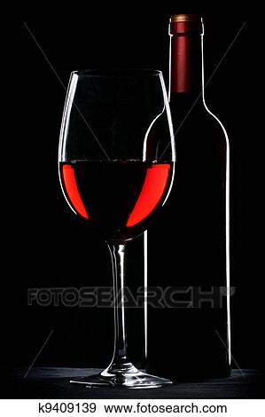 730e8aaaac9a Red wine bottle and glass silhouette over black background Stock ...