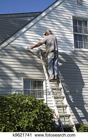Man Painting House Stock Image