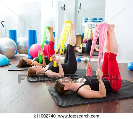 stock photography of aerobics pilates women with rubber bands in a