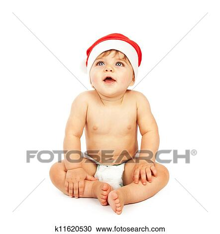 Stock Photography - Baby boy wearing christmas hat. Fotosearch - Search  Stock Photos c9bd2c76cb0